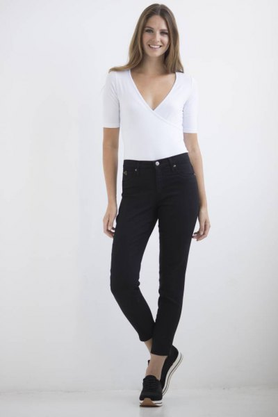white deep v neck top black ankle jeans