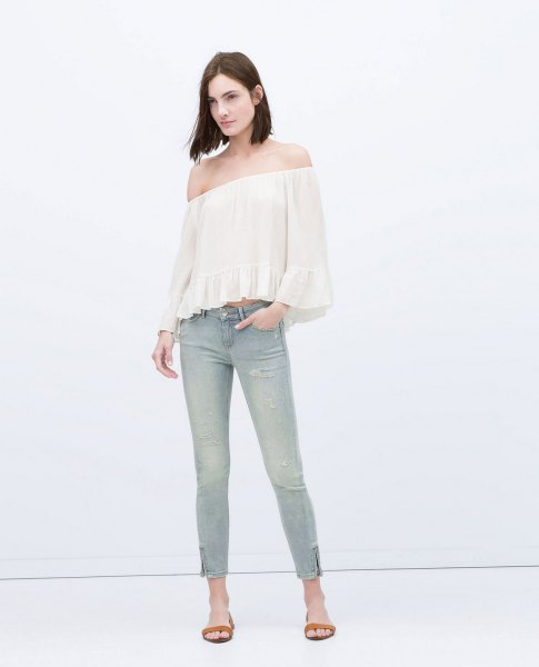 white off shoulder blouse light grey ankle zip jeans