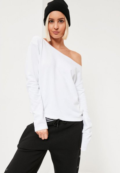 white one shoulder sweatshirt wide leg black pants