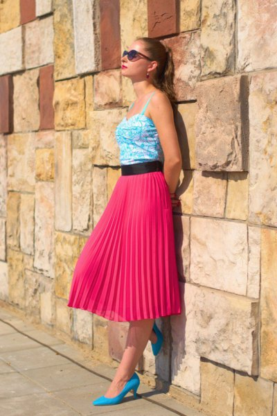white printed vest top red midi pleated skirt