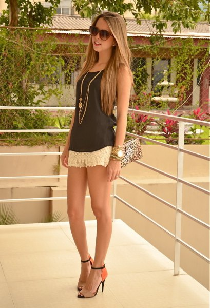 white shorts grey vest top heels
