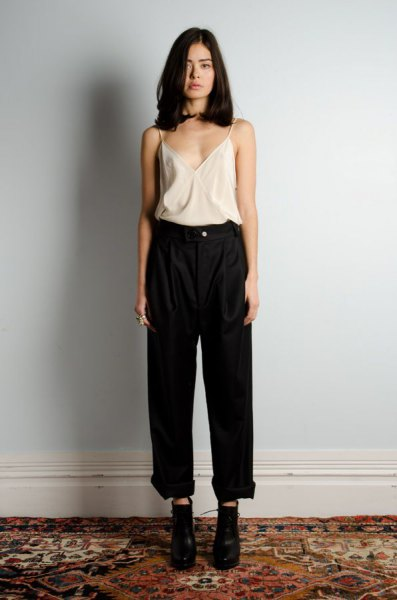 white silk camisole black high waisted wide leg jeans
