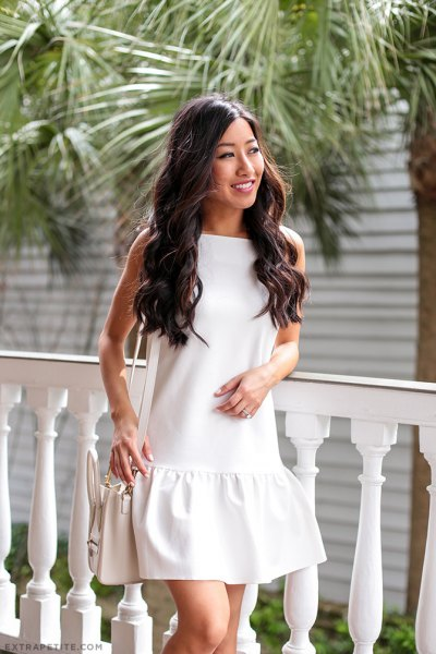 white sleeveless mini drop neck dress