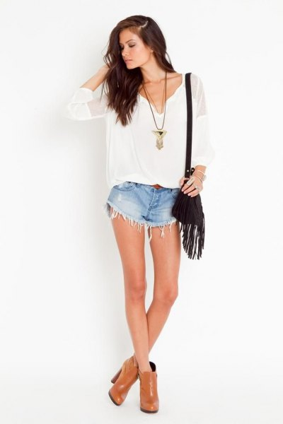 white v neck blouse blue denim fringe shorts