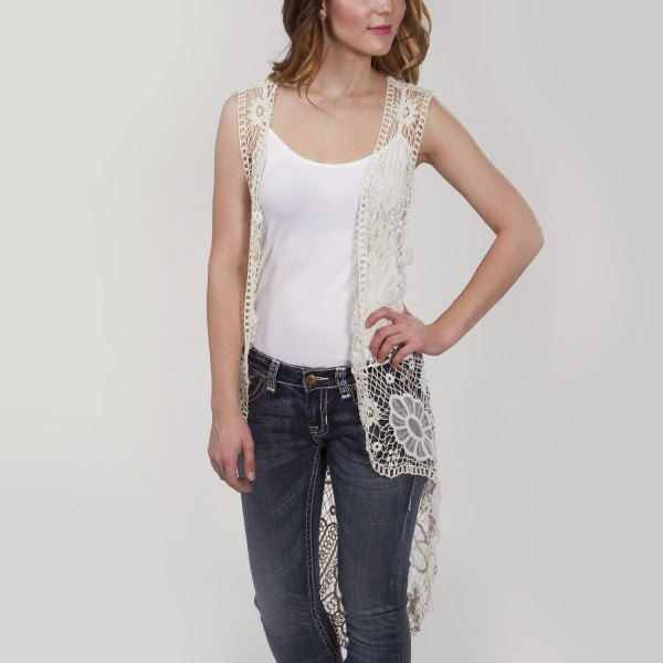 white vest top dark blue skinny jeans