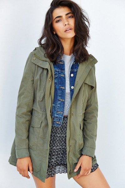 army green anorak jacket over blue denim jacket