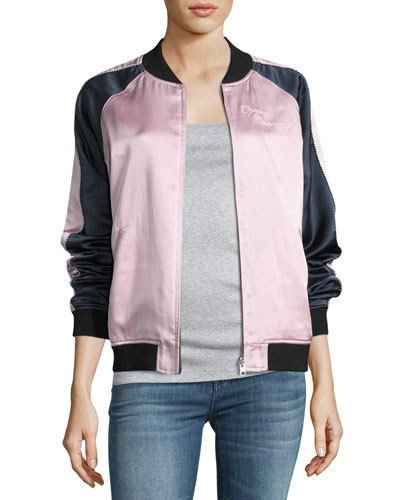 black and white silk bomber jacket with grey tee and blue jeans
