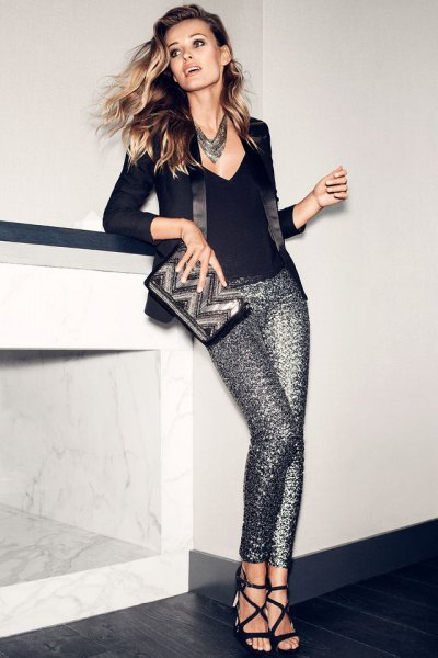 black deep v neck fitted sweater with silver glitter pants