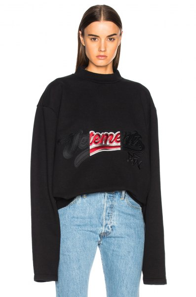 black embroidered sweatshirt with light blue mom jeans