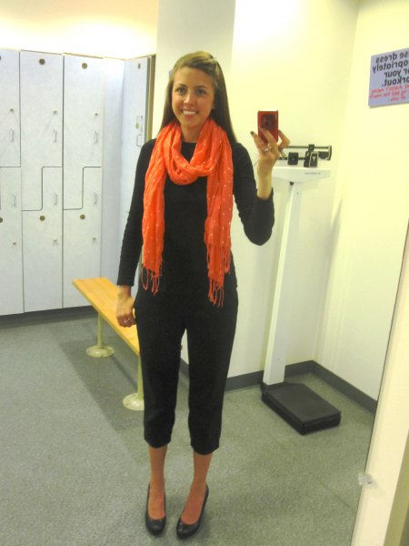 black knit sweater with capris and orange scarf