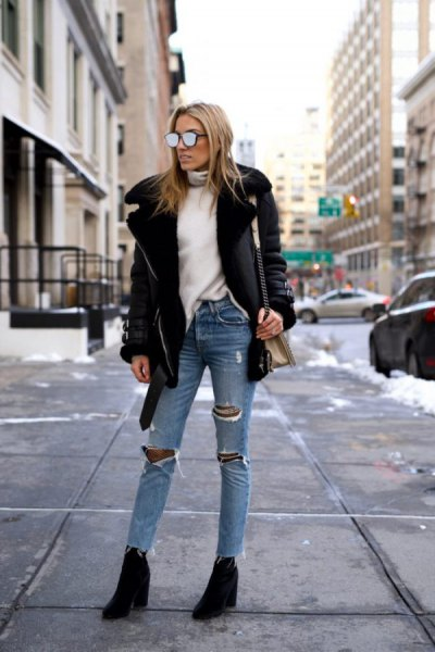 black leather shearling jacket with white turtleneck sweater