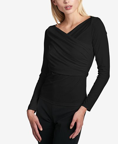 black long sleeve ruched wrap top skinny jeans