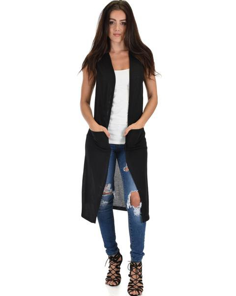 black longline sweater vest white tank top ripped jeans