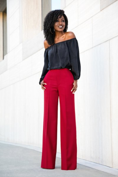black off the shoulder blouse with red wide leg pants