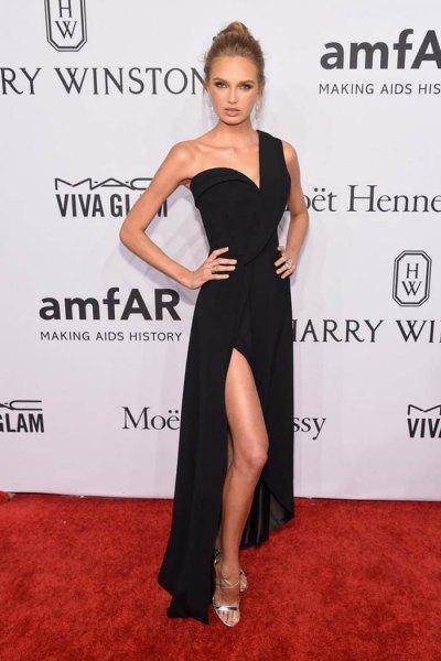 black one shoulder high split dress with silver heels