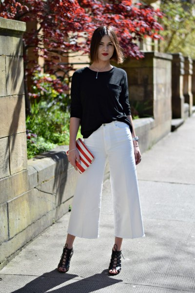 black relaxed fit sweater with white culottes