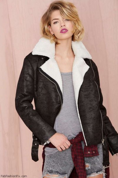 black sherpa lined jacket with grey vest top and ripped jeans