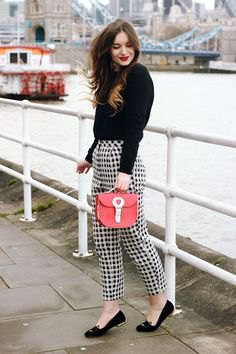 black sweater checkered pants red purse