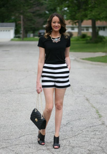 black t shirt striped shorts statement necklace