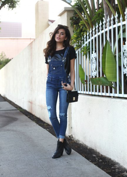 black t shirt with ripped denim skinny overalls