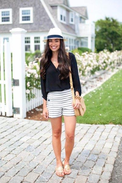 black v neck blouse with striped shorts felt hat