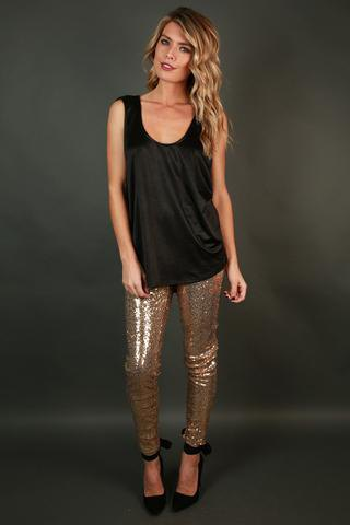 black vest top with gold sequin leggings