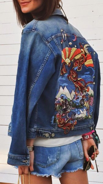 blue embroidered jacket with mini denim shorts