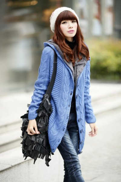 blue hooded cardigan with white knit hat