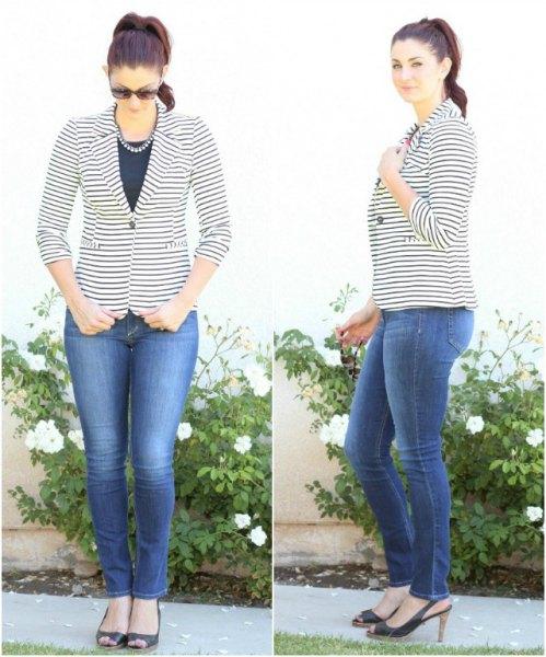 buttoned blazer black blouse blue skinny jeans