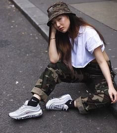 camo bucket hat with white oversized tee and camo pants