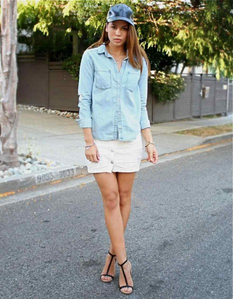 chambray shirt with white denim mini skirt and leather baseball cap