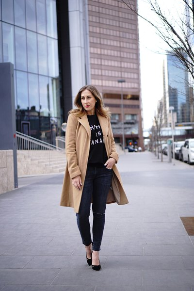 crepe long wool coat with black print tee and leather pants
