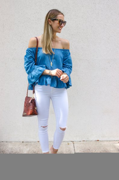 denim off the shoulder ruffle top with white ripped skinny jeans