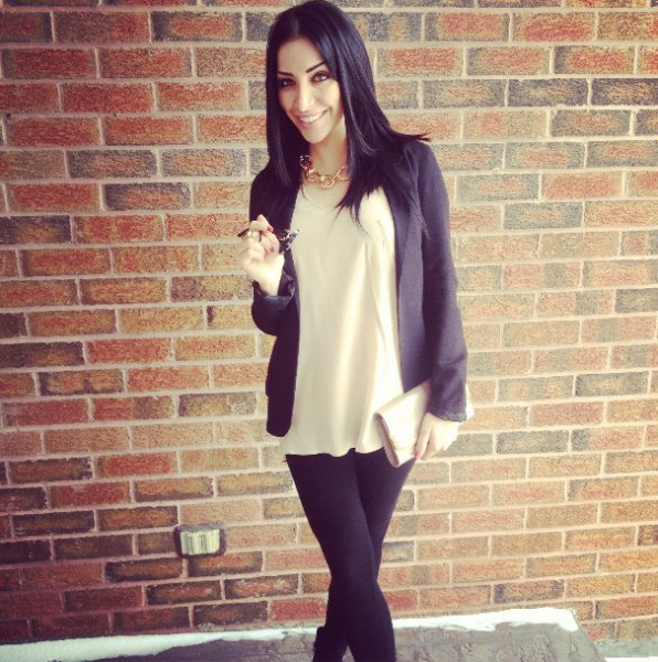 gold chain necklace with blush t shirt and black blazer