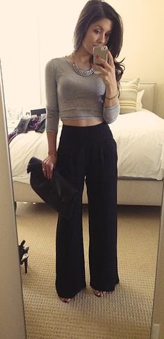 grey cropped long sleeve form fitting tee with black high waisted wide leg trousers