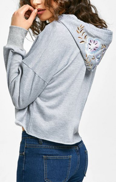 grey floral embroidered hoodie blue skinny jeans