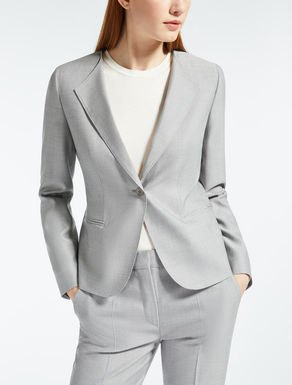 grey silk suit with white cotton long sleeve tee