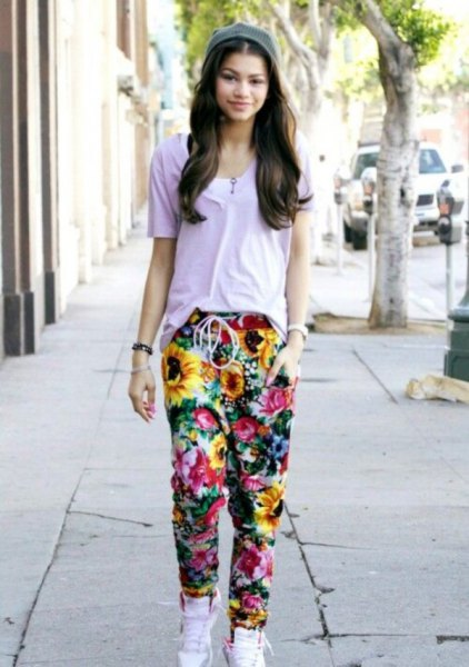 grey t shirt with floral baggy pants and white high top sneakers