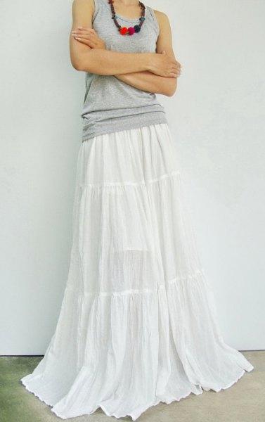 grey tank top white floor length skirt