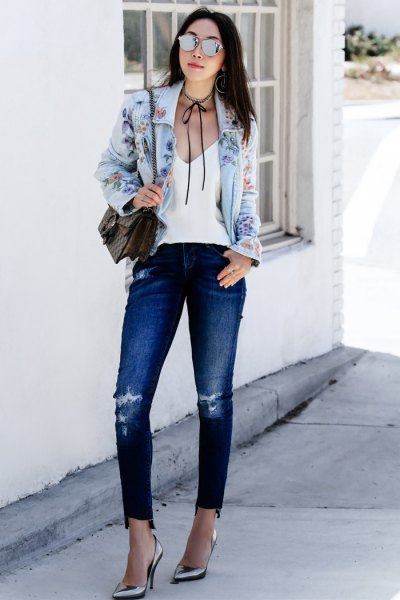 light blue embroidered denim jacket with white vest top choker