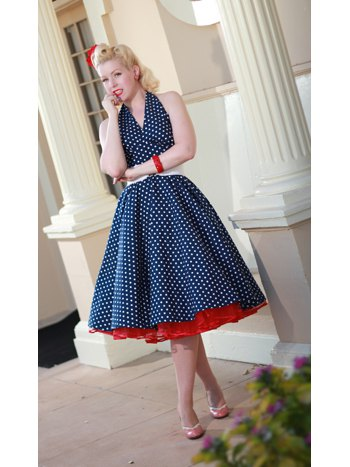 navy and white polka dot halter neck 1950s style swing dress