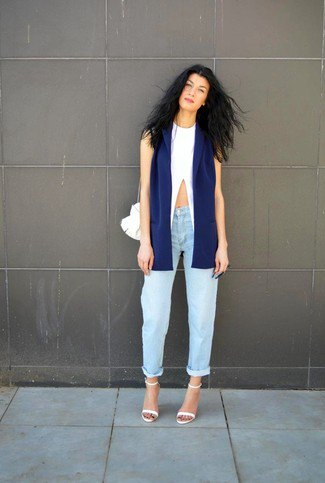 navy sleeveless blazer with white crop top and boyfriend jeans