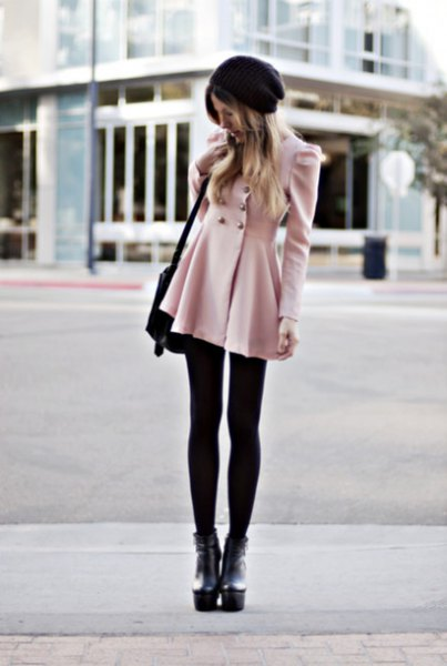 pale pink double breasted coat dress with black leggings