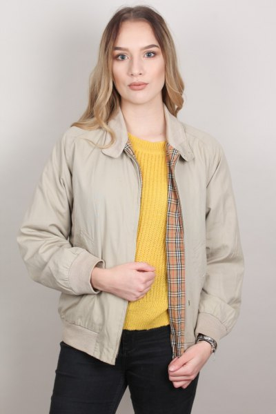 pale pink harrington jacket with lemon yellow ribbed knit sweater