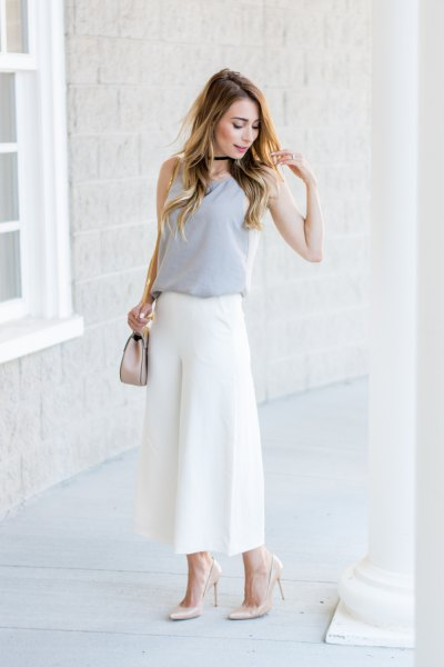 pink sleeveless blouse with white culottes