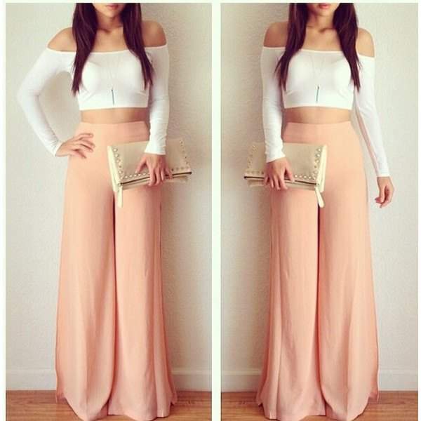pink trousers with white off the shoulder cropped form fitting top