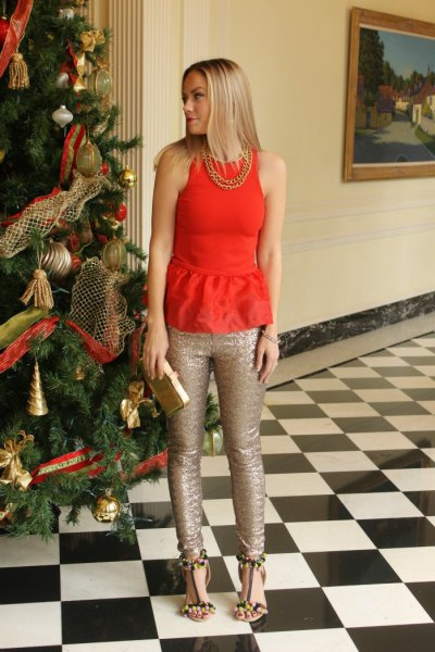 red sleeveless peplum top with rose gold skinny glitter pants