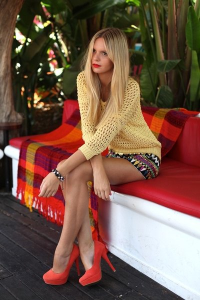 red velvet heels with pale orange sweater and printed mini skirt