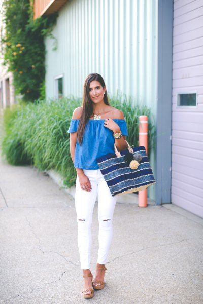royal blue off the shoulder top with white ripped skinny jeans