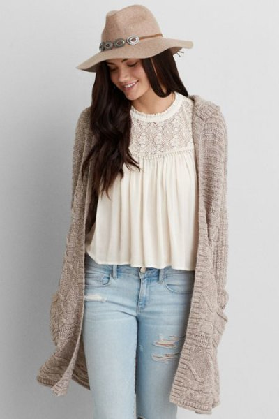 straw floopy hat with white lace blouse grey long hooded cardigan